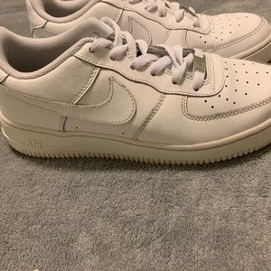 All white low top Air Force 1s